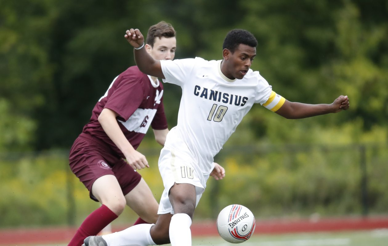 Canisius' Abel Tefera chases down a loose ball against Aquinas during the second half of Saturday's game at the Stransky Complex.  (Harry Scull Jr./Buffalo News)