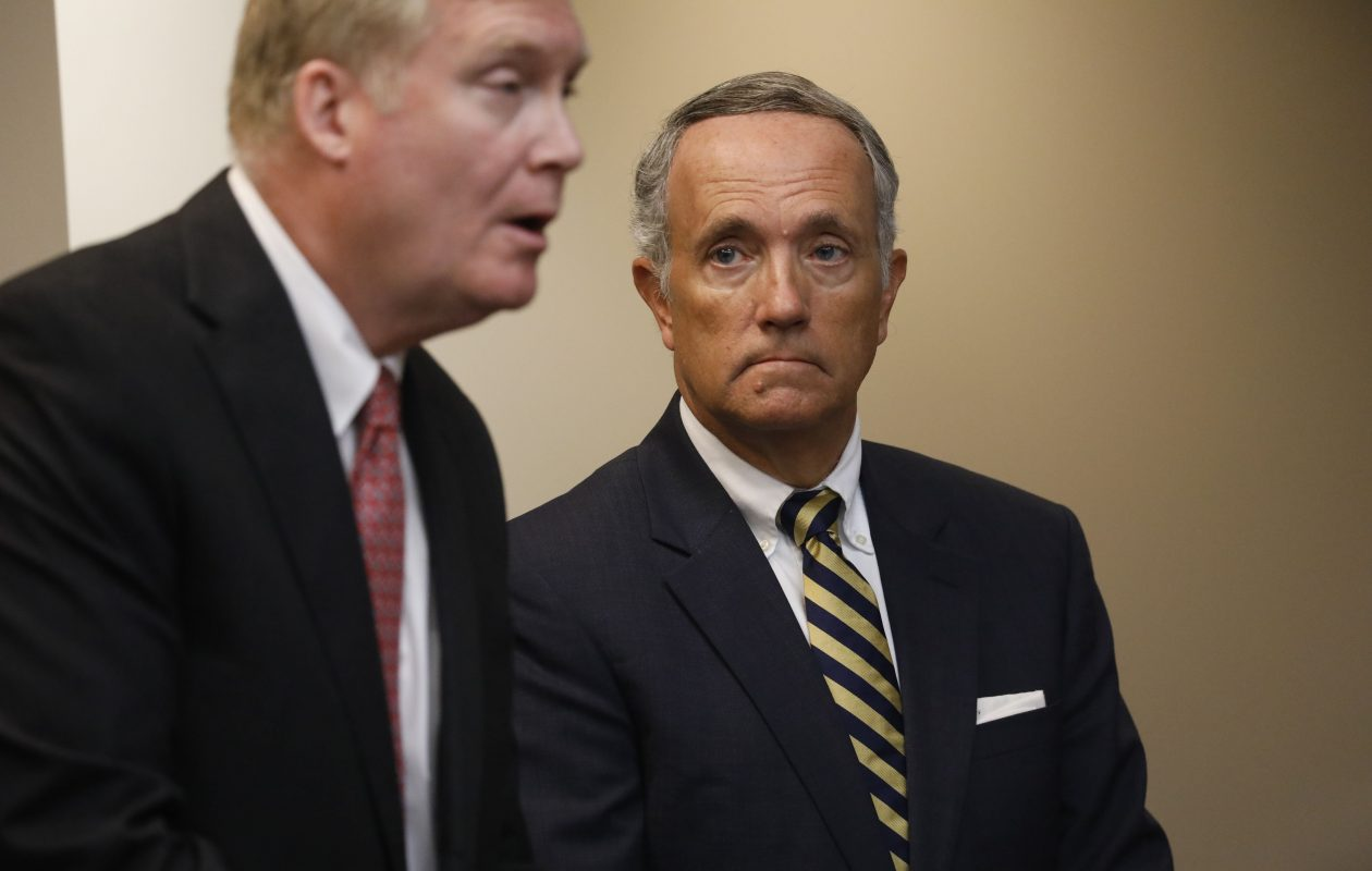 Former University at Buffalo Vice President Dennis Black looks on as defense attorney Brian Mahoney, left, speaks to the judge during a court hearing on Thursday,  (Derek Gee/Buffalo News)