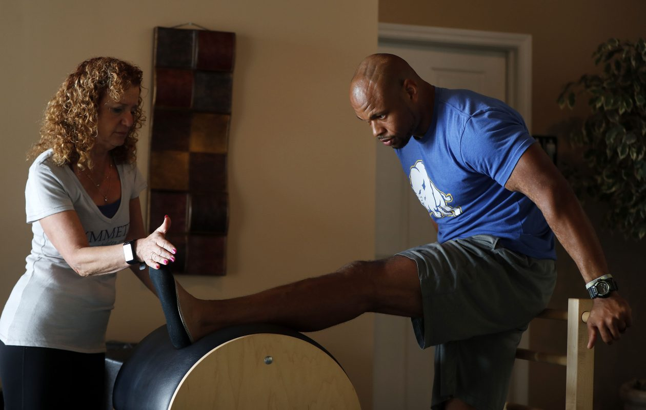 Buffalo Bills LB Lorenzo Alexander stretches out at the end of his pilates session with Judi Donner.  (Mark Mulville/Buffalo News)