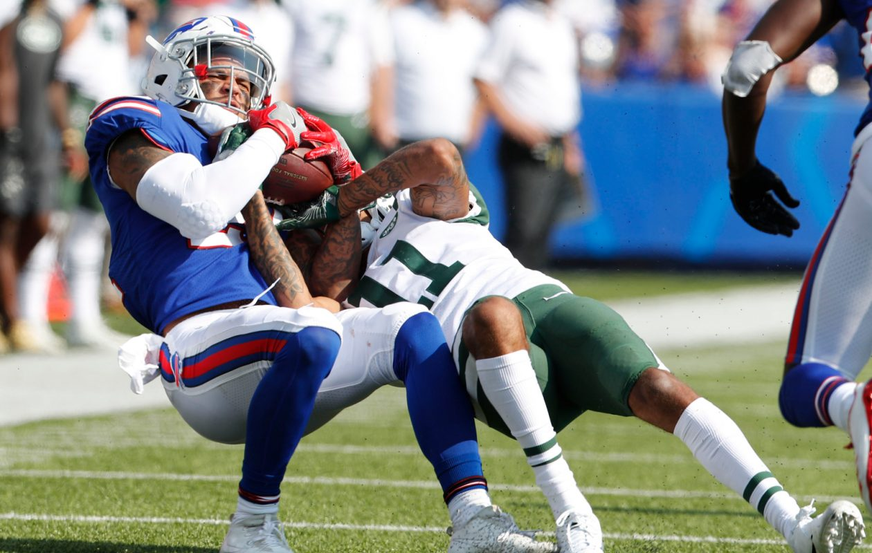 Buffalo Bills safety Jordan Poyer, left, pulls down an interception against New York Jets wide receiver Robby Anderson (11) during the fourth quarter at New Era Field in Orchard Park on Sunday, Sept. 10, 2017. (Mark Mulville/Buffalo News)
