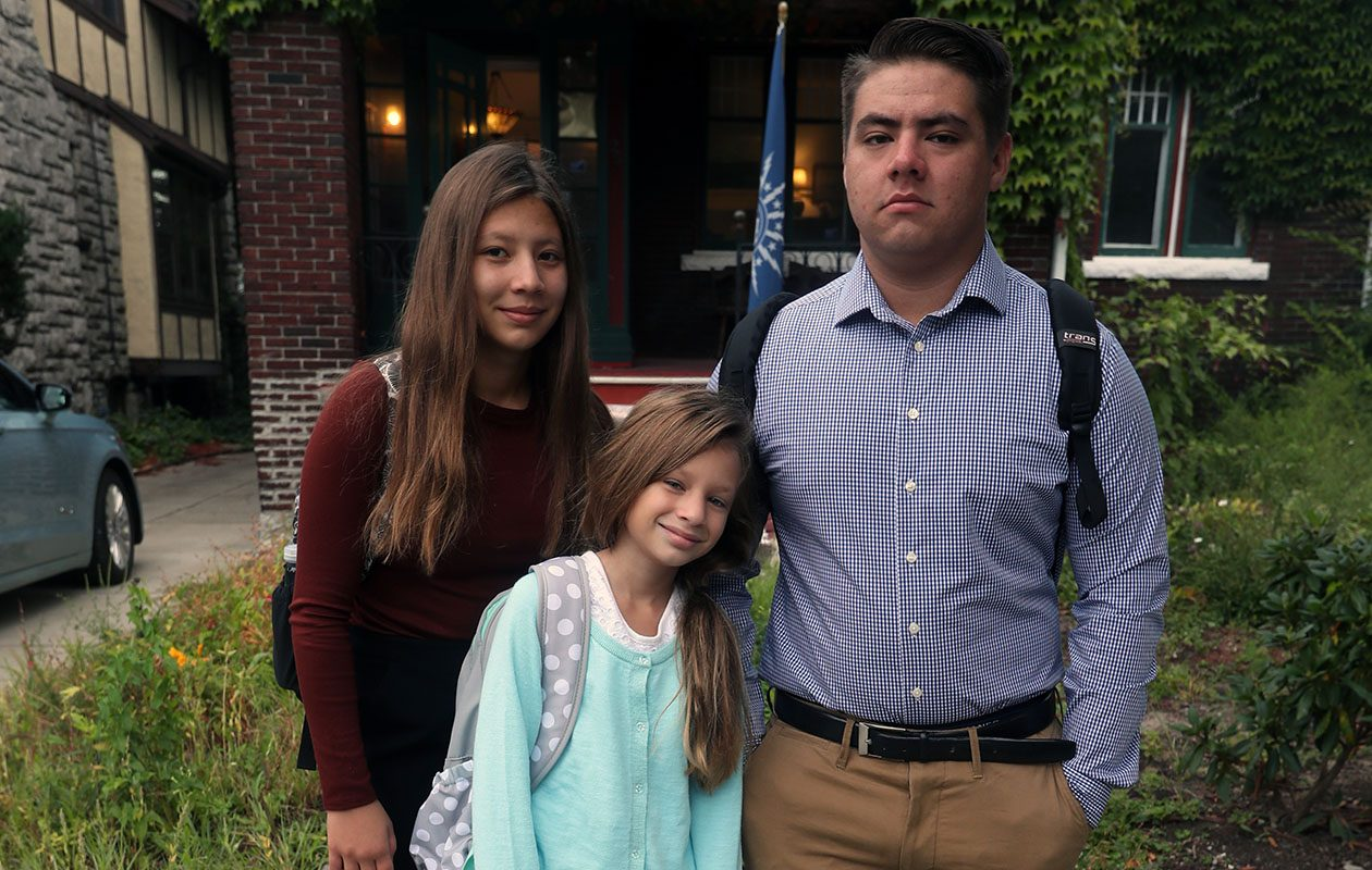Three children - Aubrie Martinez,15, left, her brother Izak,, 16,  and Emmaleigh, 8, outside  the Buffalo home of their  aunt and uncle as they prepare to go to school on  Wednesday, Sept. 13, 2017. They fled from Rockport, Texas ahead of Hurricane Harvey. Now they are living in Buffalo while their parents try to rebuild their home. (John Hickey/Buffalo News)