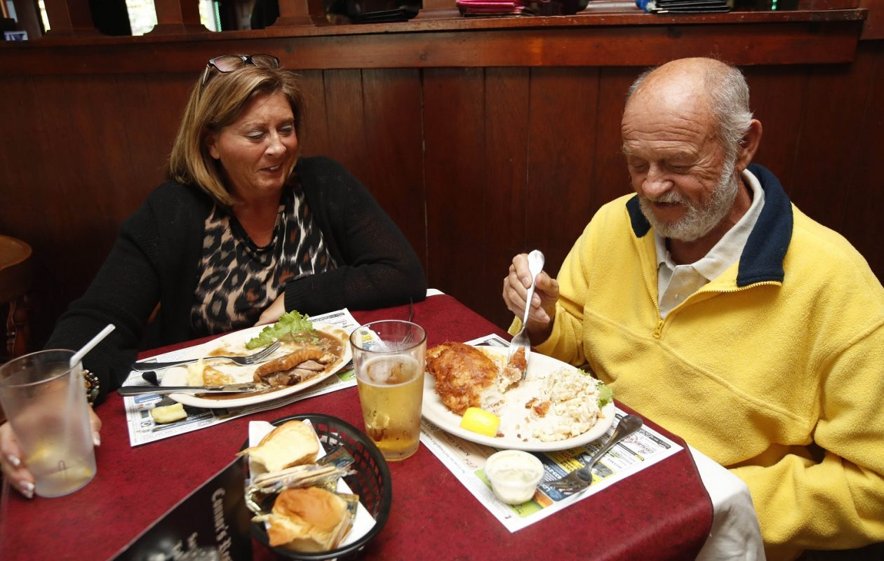 Amy Flor of Williamsville and her father Lonnie Grover of Jamestown enjoy dinner. (Sharon Cantillon/Buffalo News)