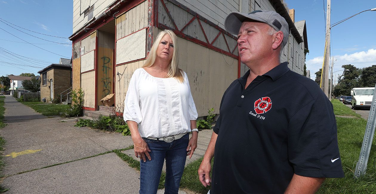 William and Marilyn Orndorff of Newfane stand in front of the vacant Niagara Falls house where their pregnant daughter, Alicia M. Davidson, 36, was first arrested. (John Hickey/Buffalo News)