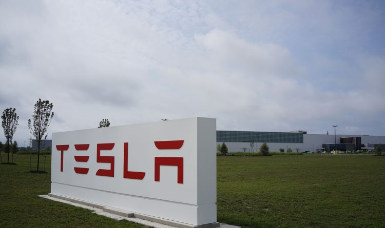 Tesla sign goes up as it begins seeking production staff