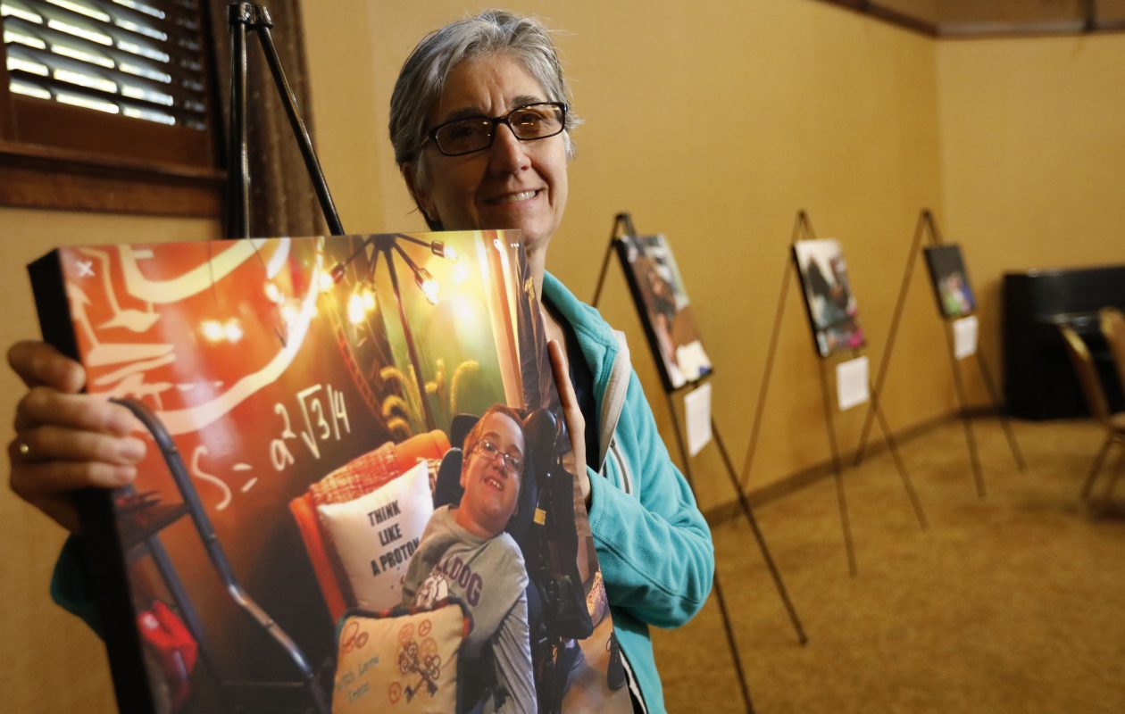 Diane Blaire holds a photograph she took of her son Alex, 14, which is on display at Hospice Buffalo for the Photographs of Meaning Program, Friday, Sept. 15, 2017.  Alex has spinal muscular atrophy, a form of muscular distrophy.  (Derek Gee/Buffalo News)