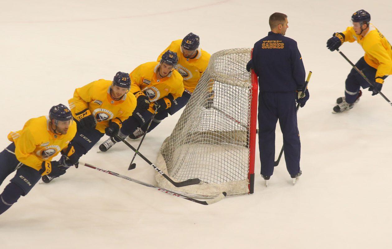 From left, Justin Bailey, Sam Reinhart, Stevie Moses, Benoit Pouliot and Austin Osmanski circle the net and Sabres assistant coach Chris Hajt. (John Hickey/Buffalo News)