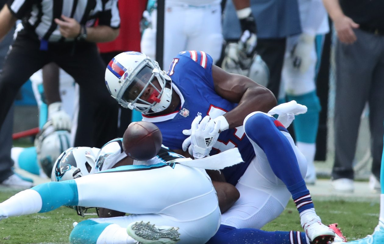 Buffalo Bills wide receiver Zay Jones (11) drops the ball after getting hit by Carolina Panthers cornerback James Bradberry (24) in the third quarter. (James P. McCoy / Buffalo News)