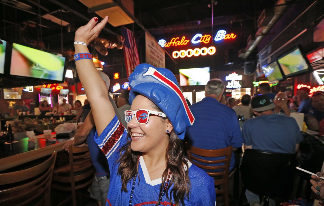 Brittany Rudy, originally of Buffalo, pulls out all the stops to cheer on her team with others. Expats and Buffalo Bills football fans from the Greater Tampa-St. Petersburg, Fla., region assembled  as they often do at Buffalo City Bar & Grill in St. Petersburg on Sunday, Sept. 17, 2017. (Robert Kirkham/Buffalo News)
