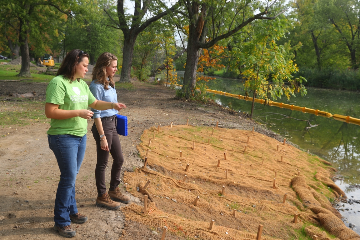 Jill Jedlicka, executive director of Buffalo Niagara Waterkeeper, left, with senior landscape designer Erica Grohol look over the work being done on the latest 'living shoreline' project. (John Hickey/Buffalo News)