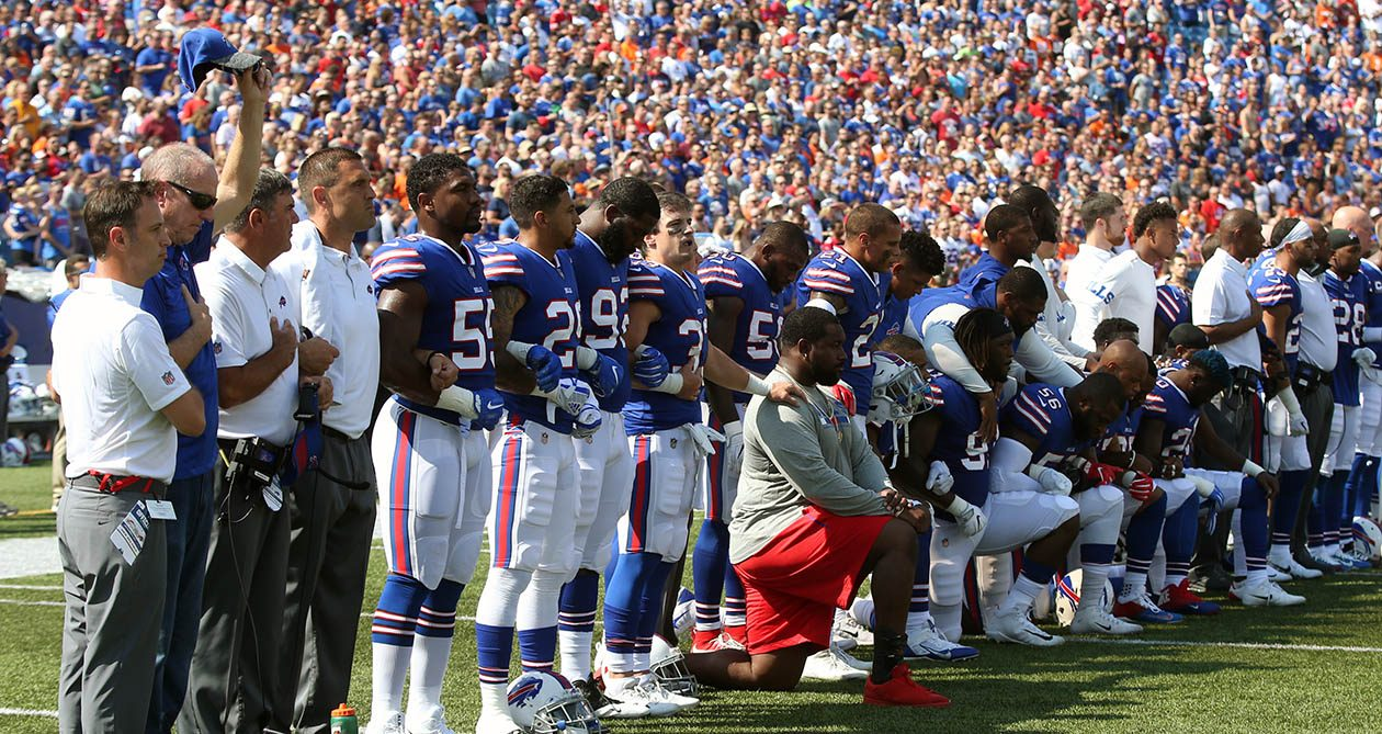 Hall of Fame quarterback Jim Kelly joined the Bills on the field for the national anthem during Sunday's game. Jerry Hughes said Monday that he was unaware Kelly would be joining the team. (James P. McCoy/News file photo)