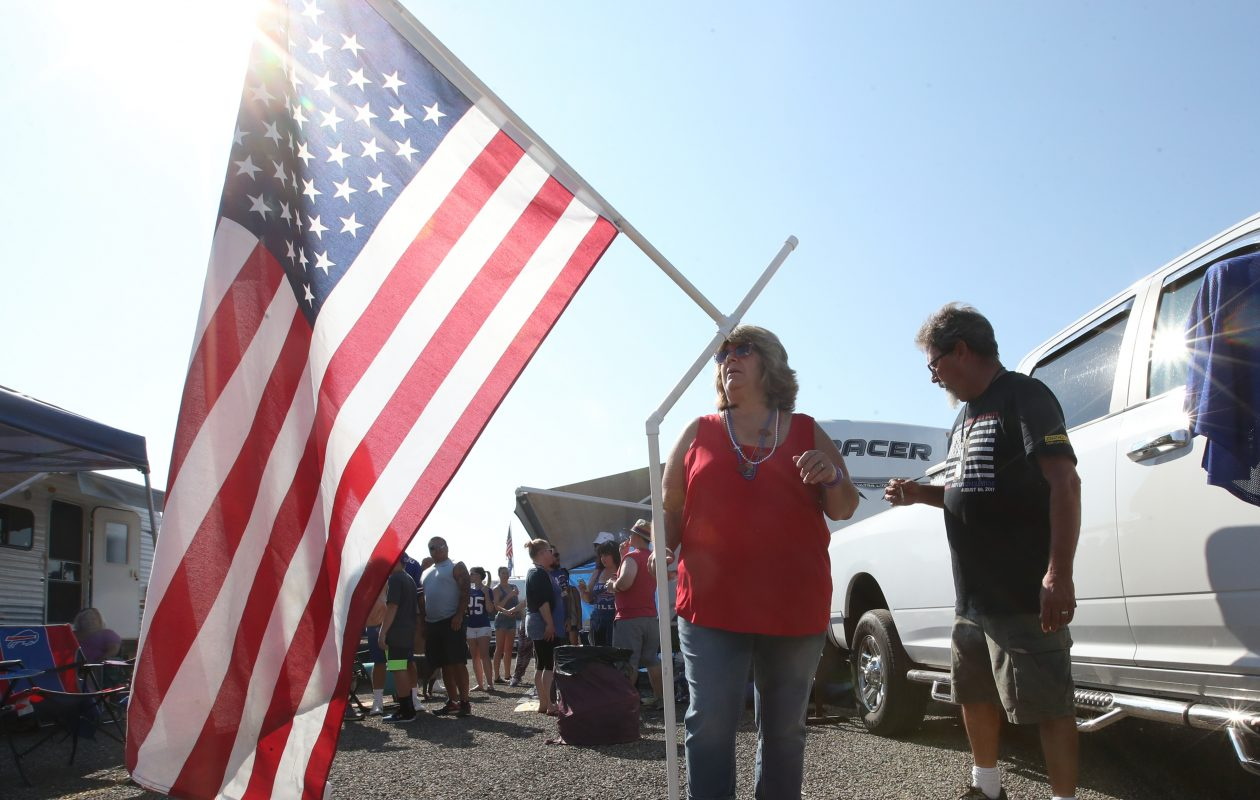 Bill and Kim Wilson honor their fallen son, Billy, while displaying an American flag at their pregame tailgate. Billy Wilson was killed in Afghanistan. (James P. McCoy/Buffalo News)