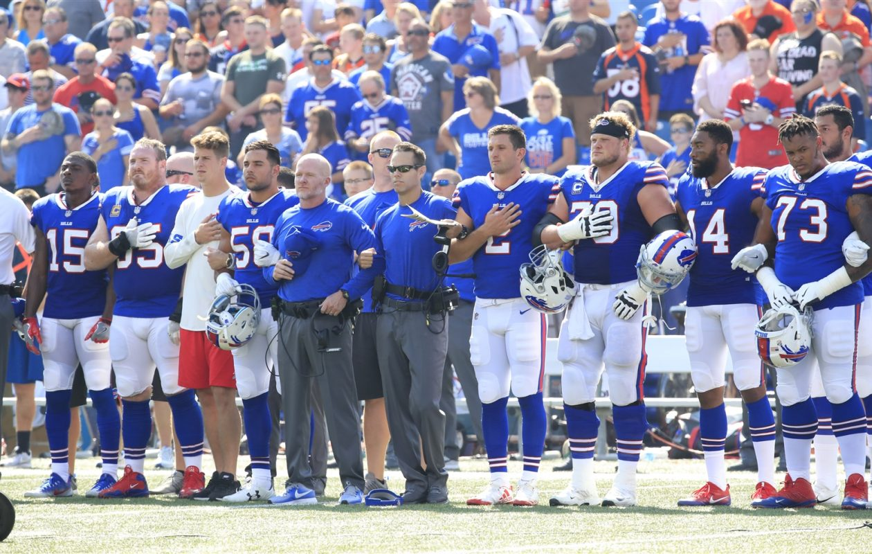 Center Eric Wood (70) and defensive tackle Kyle Williams (95), team captains for the Buffalo Bills, said they're not sure if players will continue to stage protests during the national anthem. (Harry Scull Jr./Buffalo News)