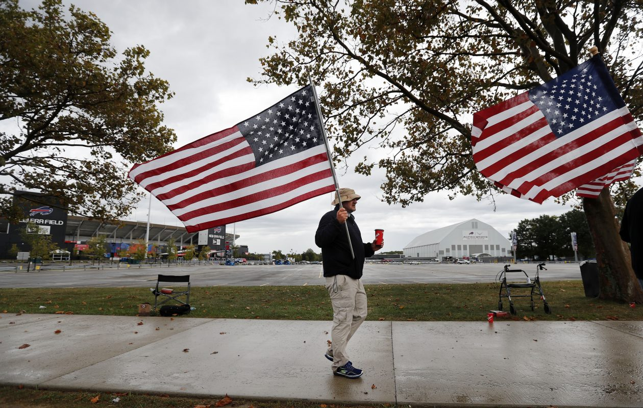 Ed Houck and others carry American flags along Abbott Rd in front of New Era Field to draw attention in support for the flag and for respect of the National Anthem Friday, Sept. 29, 2017.  (Mark Mulville/Buffalo News)