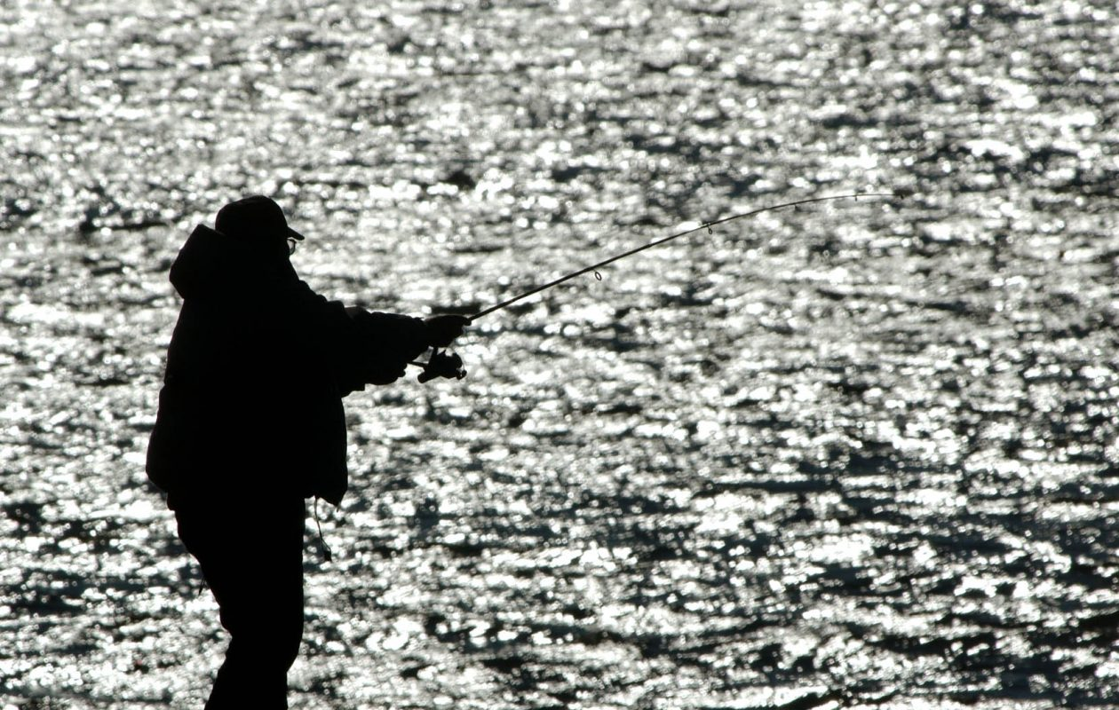 A man fishes off a pier in the Niagara River in the Riverside section of Buffalo. (Buffalo News file photo)
