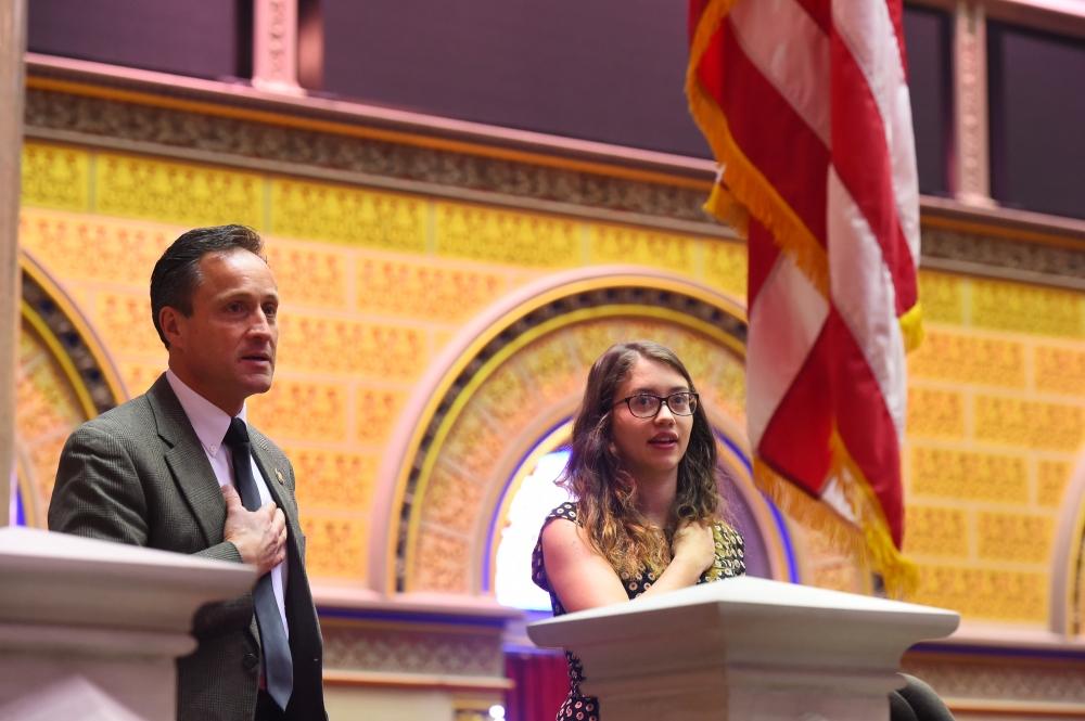 Assemblyman Lopez recites the Pledge of Allegiance with a student. (Courtesy: Assemblyman Pete Lopez)