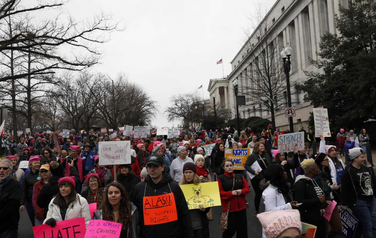 Protesters march past the Rayburn House Office Building during the Women's March on Washington on Jan. 21, 2017, in Washington, D.C. (Photo by Aaron P. Bernstein/Getty Images)
