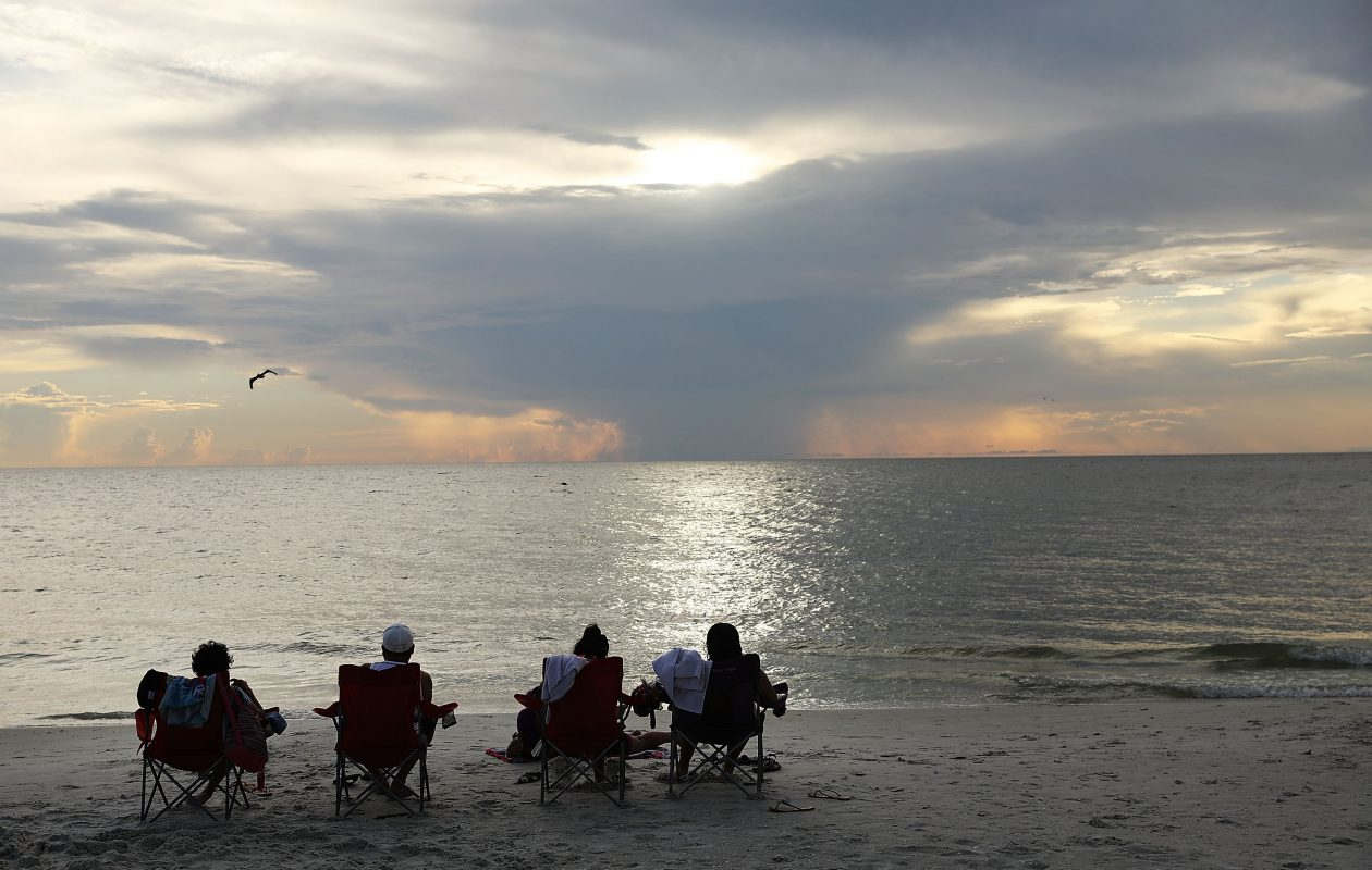 People enjoy the beaches and fishing pier in Naples, Fla., before the arrival of Hurricane Irma on Sept. 8, 2017. The Naples area could begin to feel hurricane-force winds from Irma by 11 a.m. Sunday and experience  wind gusts over 100 mph from Sunday through Monday. (Photo by Spencer Platt/Getty Images)