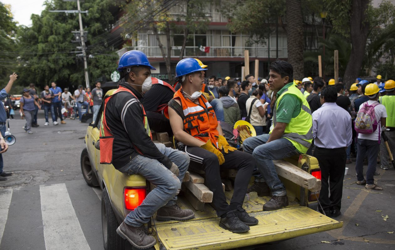 Rescue workers gather at Parque Mexico in the Condesa district the day after an earthquake on Sept. 20, 2017, in Mexico City, Mexico. Emergency workers continue to search the rubble after a 7.1 magnitude earthquake struck on Sept. 19. The total death toll is at least 230 with many more still number missing. (Photo by Rafael S. Fabres/Getty Images)