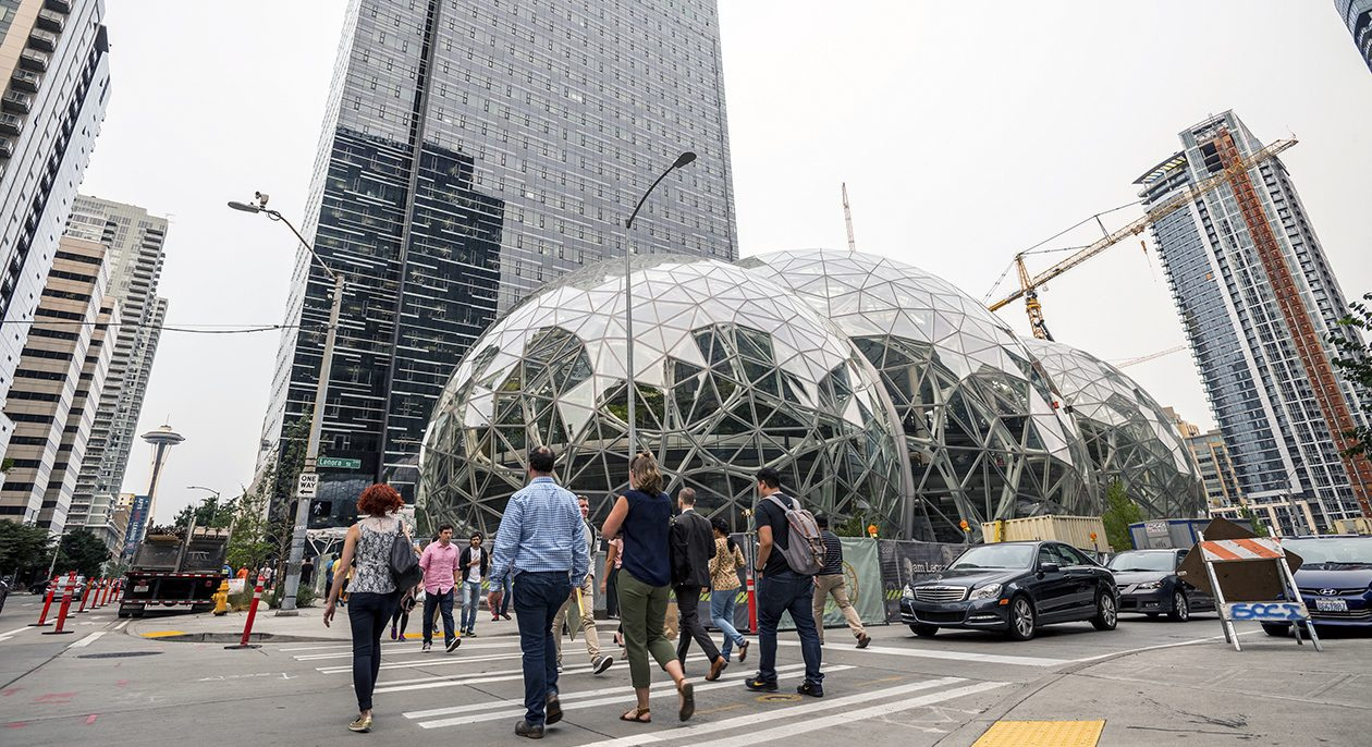 Pedestrians walk past a recently built trio of geodesic domes that are part of the Seattle headquarters for Amazon. The online retail giant is searching for a second headquarters in North America, and Buffalo wants to be in the running. (Stuart Isett/The New York Times)