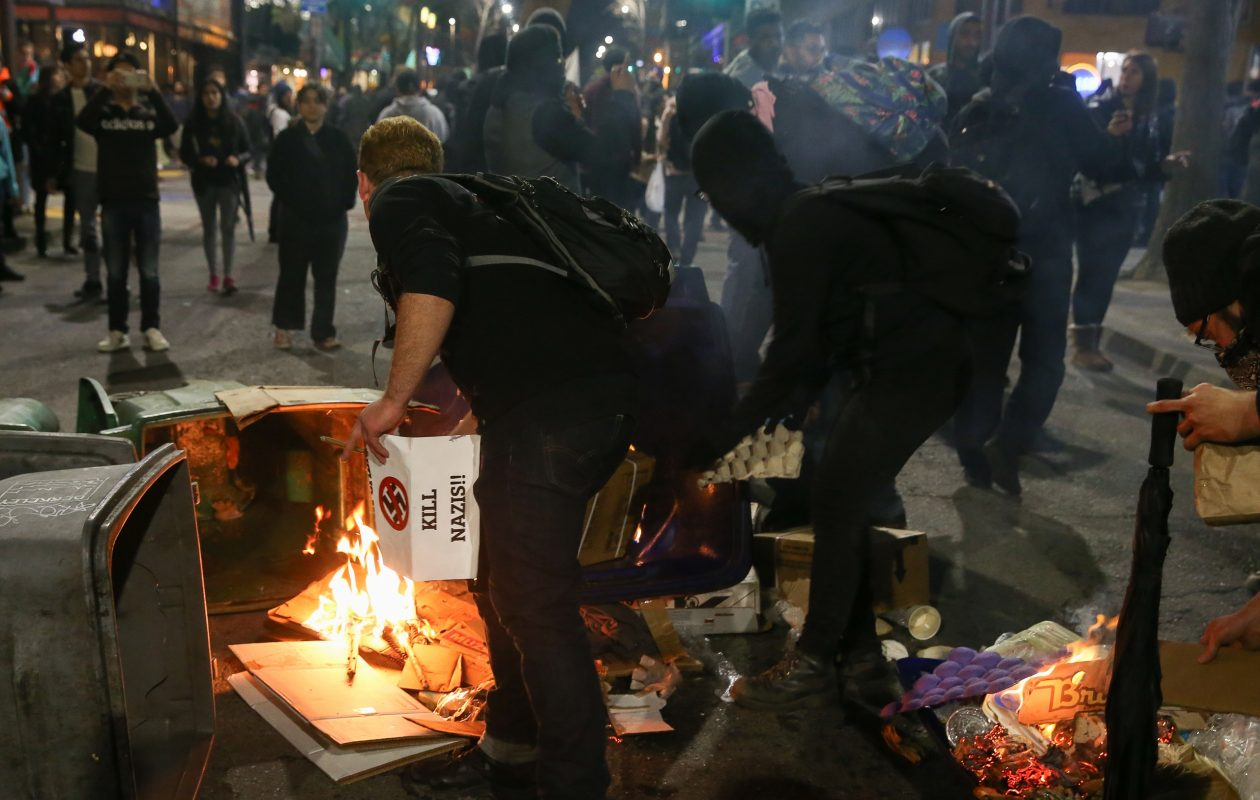 People protesting controversial Breitbart writer Milo Yiannopoulos burn trash and cardboard in the street on February 1, 2017, in Berkeley, Calif. A scheduled speech by Yiannopoulos was canceled after protesters and police engaged in violent skirmishes. (Getty Images)