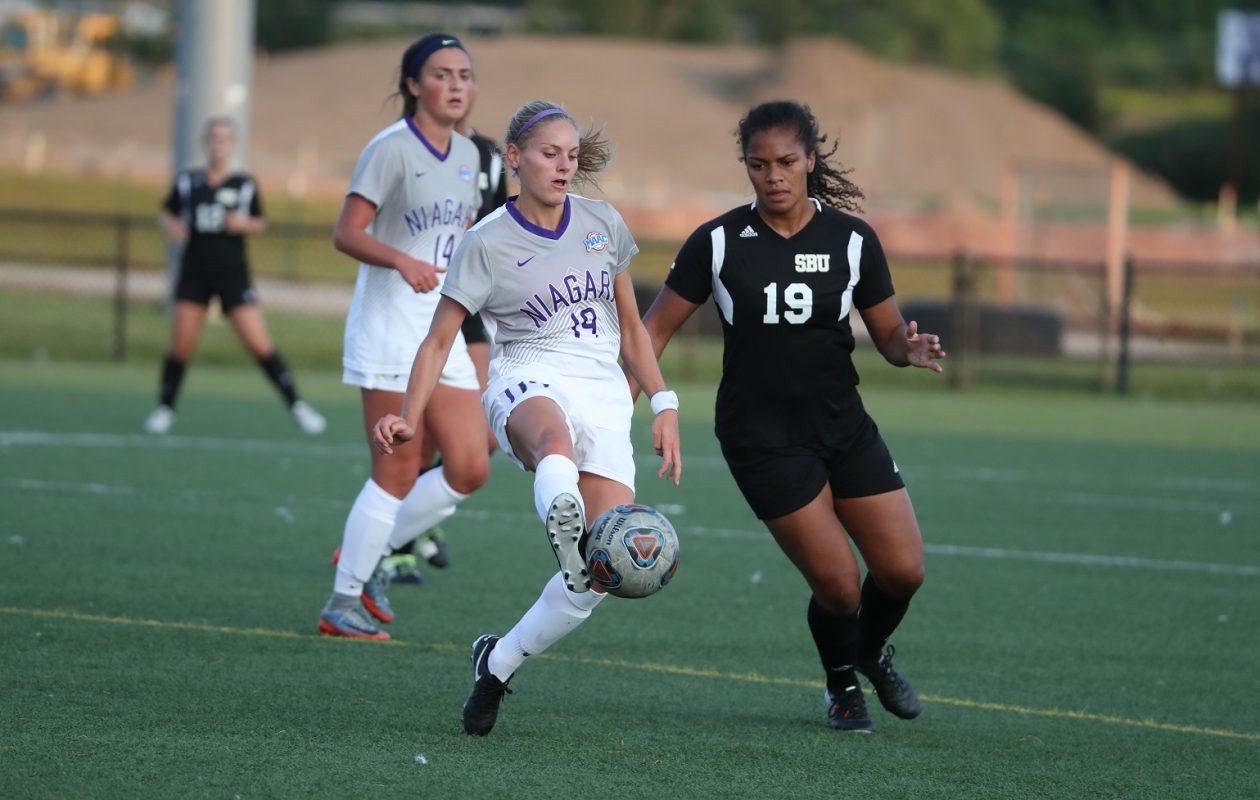 Niagara Purple Eagles midfielder Eva Bachmann, No. 19 in white, has been central to the team's strong start. (via Niagara Athletics)