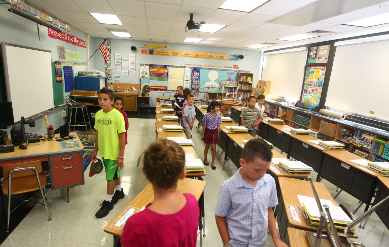 Children get a look at a classroom at Kaegebein Elementary with Principal Mary Haggerty as she conducts an orientation for new students on  Wednesday, Aug. 30, 2017.   (John Hickey/Buffalo News)