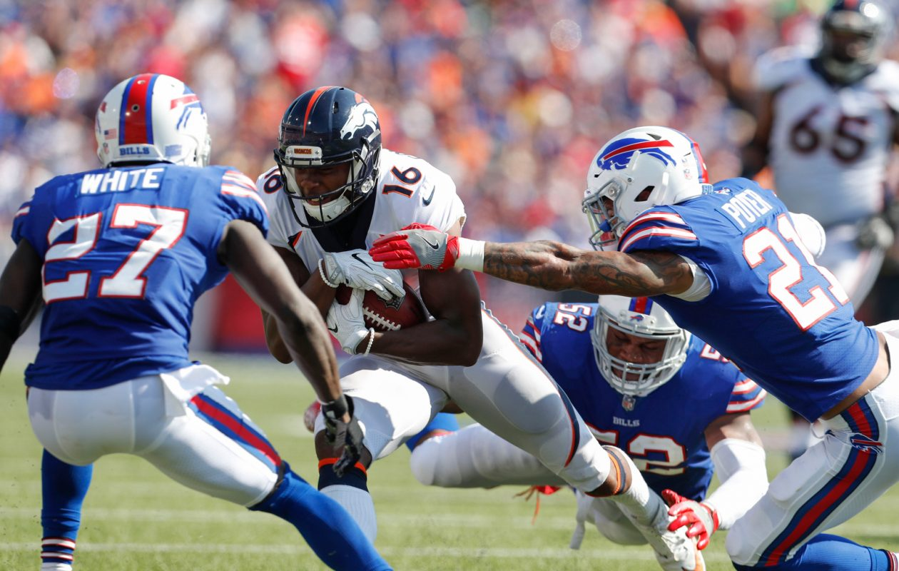 Denver Broncos wide receiver Bennie Fowler III (16) looks for yards as Buffalo Bills defenders Tre'Davious White (27) Jordan Poyer (21) and Preston Brown (52) close in during the third quarter at New Era Field in Orchard Park on Sunday, Sept. 24, 2017. (Mark Mulville/Buffalo News)
