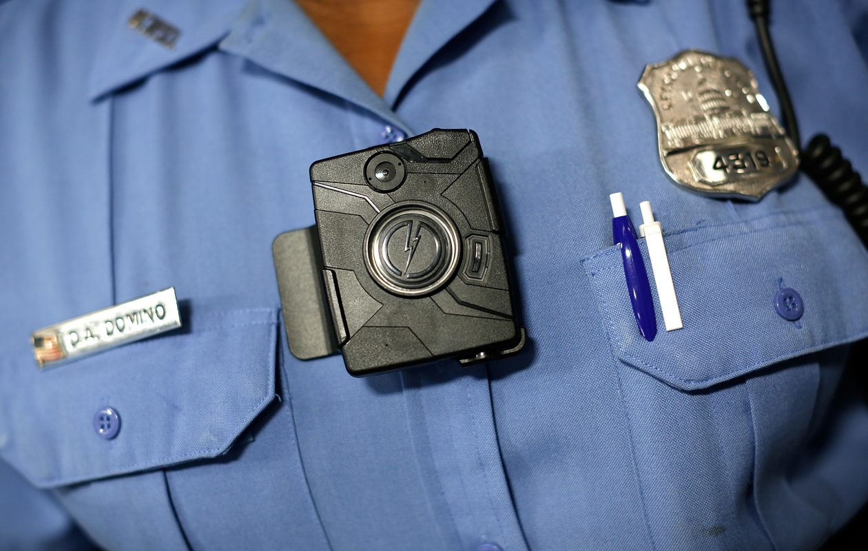 Buffalo police plan to begin a pilot program where 15 officers would wear body cameras, such as the one modeled here by a Washington, D.C., officer. Later, all 500 Buffalo patrol officers would use the equipment.  (Win McNamee/Getty Images file photo)