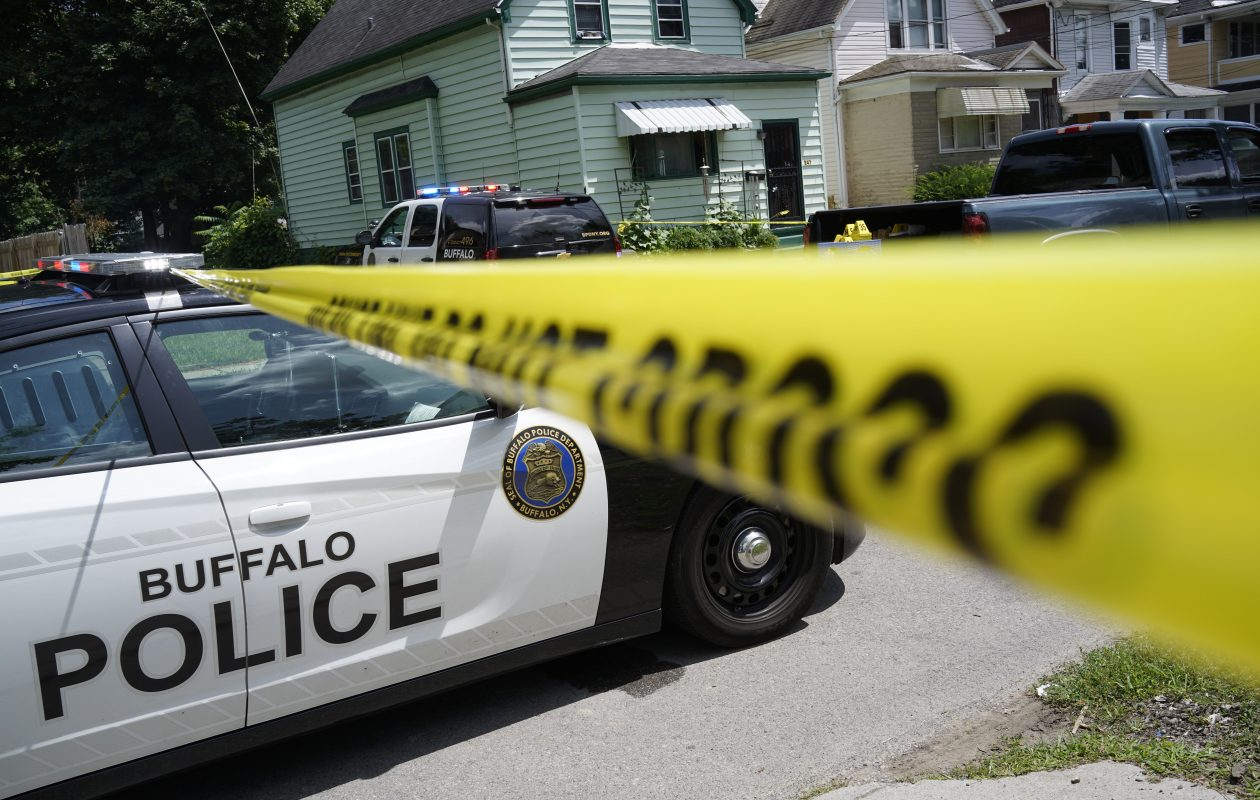 Buffalo police collect evidence on Carl Street after five people were shot there July 29, 2017.  (Derek Gee/Buffalo News)