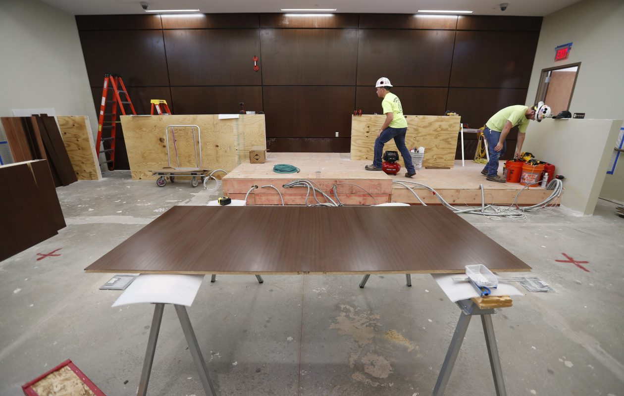 Work crews put the finishing touches on a judge's bench in a courtroom at the new Clarence Public Safety Building on Wednesday, Sept. 13, 2017.  The building is located next to the Town Hall. (Mark Mulville/Buffalo News)