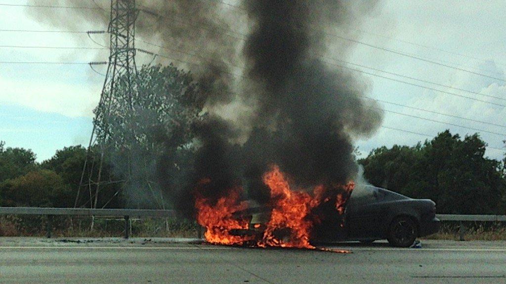 A car on fire on 90 westbound near the 190 exist. (T.J. Pignataro/Buffalo News)
