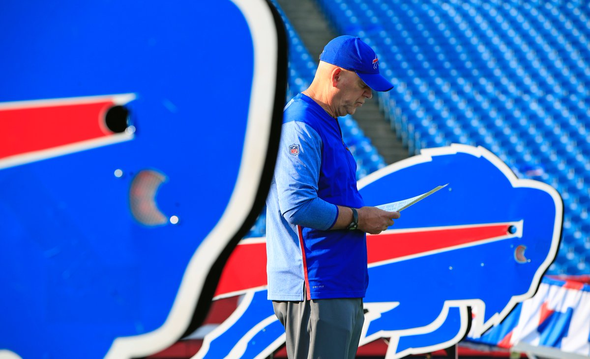 Bills defensive line coach looks at his notes prior to Sunday's season opener against the New York Jets. (Harry Scull Jr./Buffalo News)