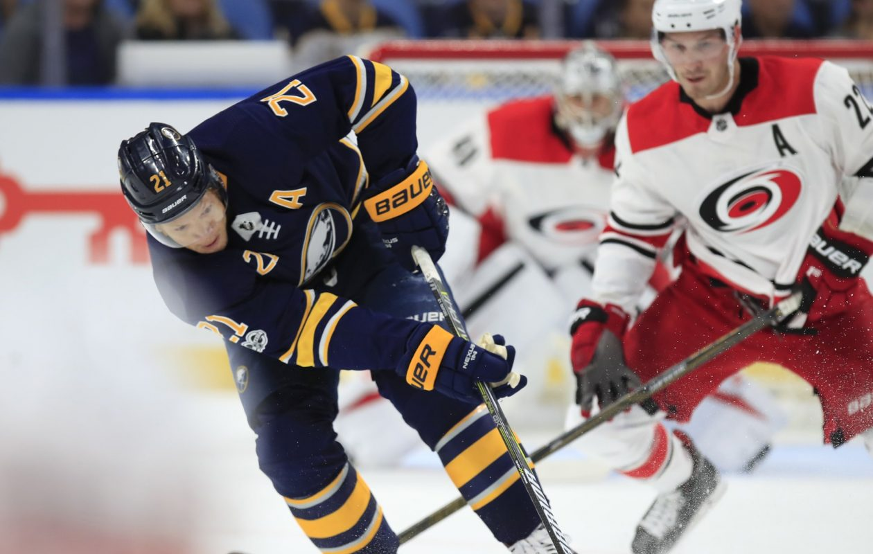 The Sabres' Kyle Okposo crosses in front of Carolina's Brett Pesce during the preseason opener for both teams Monday. (Harry Scull Jr./Buffalo News)