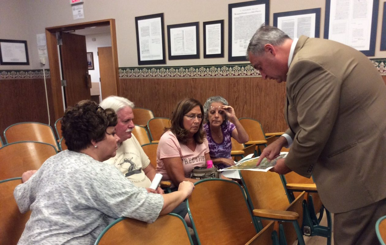 David Stapleton, owner of David Builders, takes some time after the meeting to discuss his plans with residents