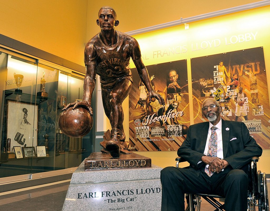 The late Earl Lloyd, first African-American to play in the National Basketball Association, with a statue built in his honor at West Virginia State. (Image courtesy West Virginia State University)