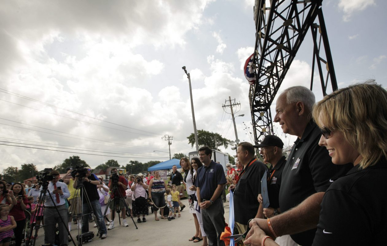 Dennis Lang, CEO of the Erie County Agricultural Society, and Jessica Underberg, assistant fair manager, cut the ribbon at the historic McKinley Parkway gate as the official opening of the Erie County Fair in this file photo. (Derek Gee/Buffalo News file photo)