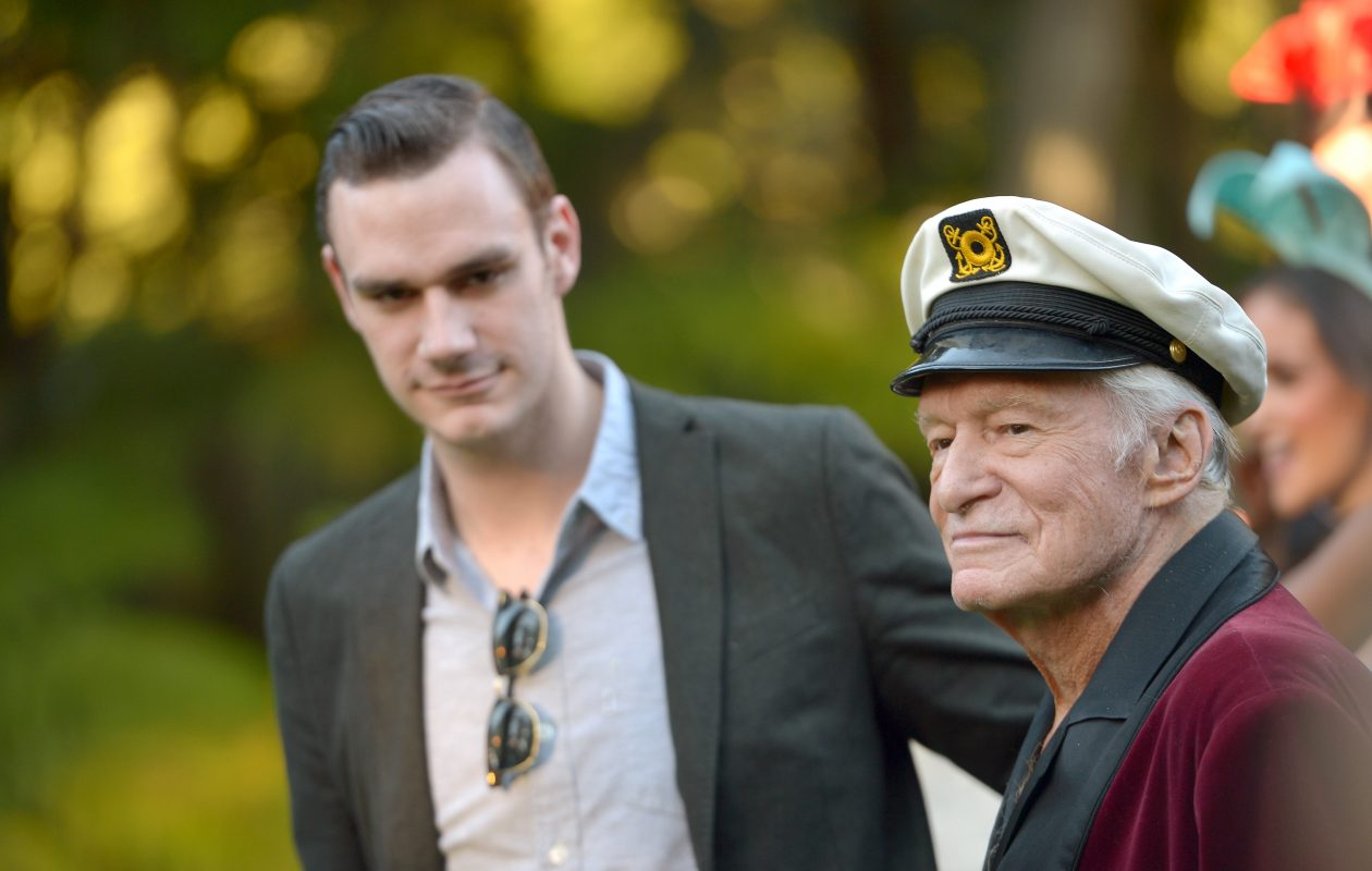 Cooper Hefner and Hugh Hefner pose at Playboys 60th Anniversary special event in 2014 in Los Angeles. (Photo by Charley Gallay/Getty Images for Playboy)