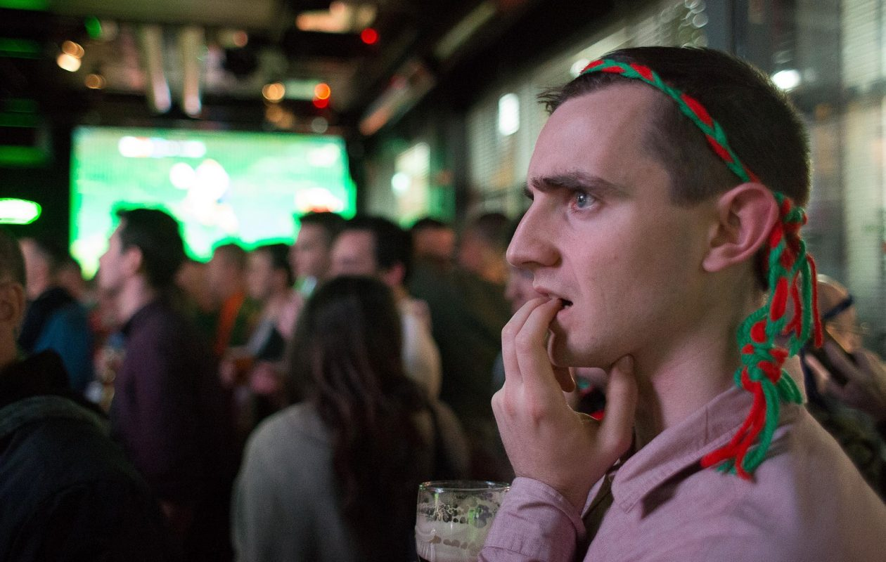 A Mayo supporter reacts as he watches GAA All-Ireland Gaelic Football Final replay match between Dublin and Mayo in a city centre pub in Dublin, Ireland, on Oct. 1, 2016. (Karl Burke/AFP/Getty Images)