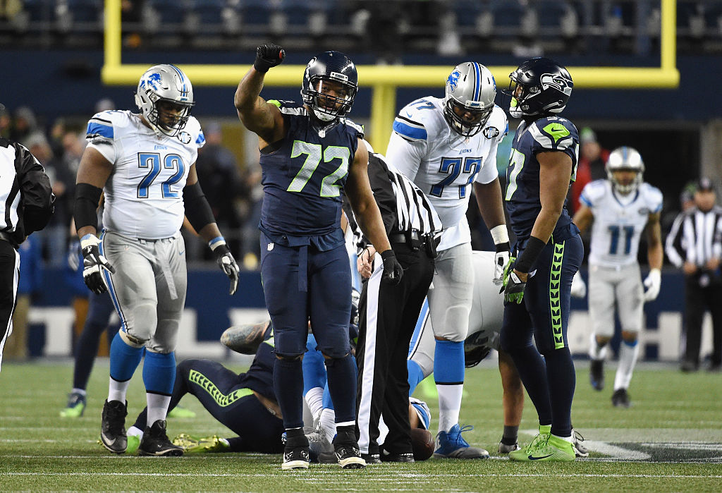 Michael Bennett #72 of the Seattle Seahawks reacts after a sack during the second half against the Detroit Lions in the NFC Wild Card game at CenturyLink Field on January 7, 2017 in Seattle, Washington.  (Photo by Steve Dykes/Getty Images)