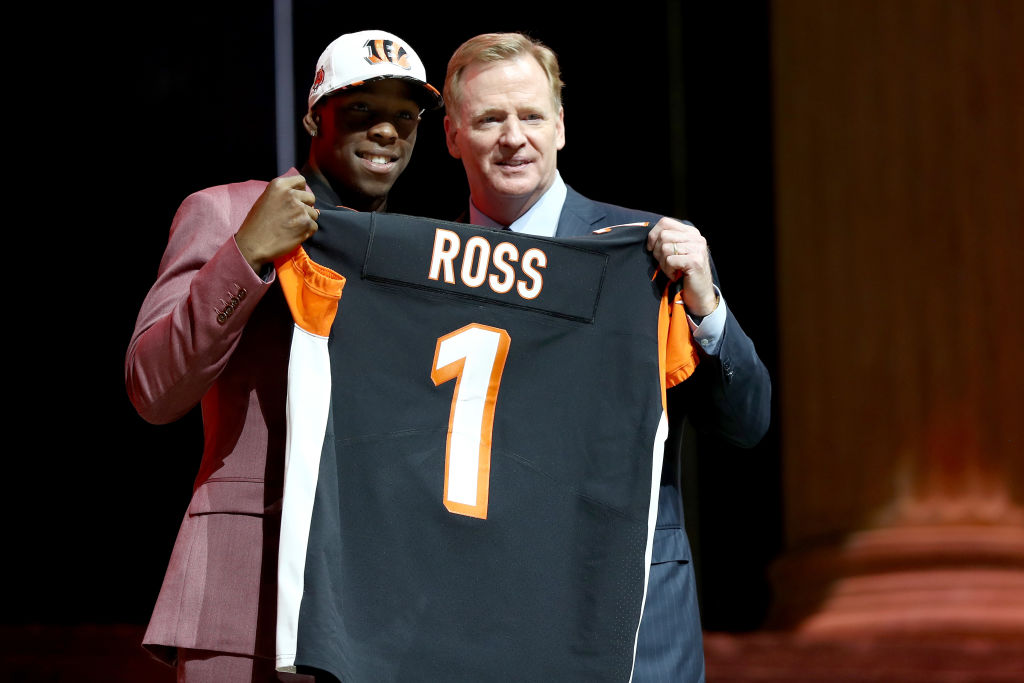 John Ross of Washington poses withc Commissioner Roger Goodell after being picked #9 overall by the Cincinnati Bengals during the first round of the 2017 NFL Draft at the Philadelphia Museum of Art on April 27, 2017 in Philadelphia, Pennsylvania.  (Photo by Elsa/Getty Images)