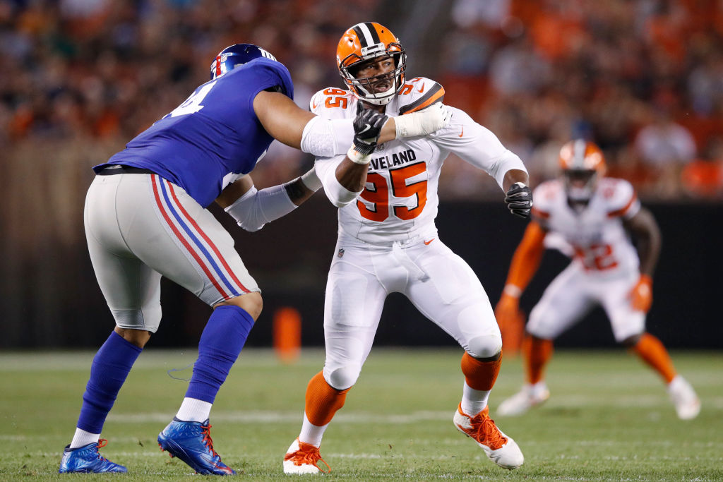 Myles Garrett #95 of the Cleveland Browns tries to get past a block by Ereck Flowers #74 of the New York Giants in the first half of a preseason game at FirstEnergy Stadium on August 21, 2017 in Cleveland, Ohio. (Photo by Joe Robbins/Getty Images)