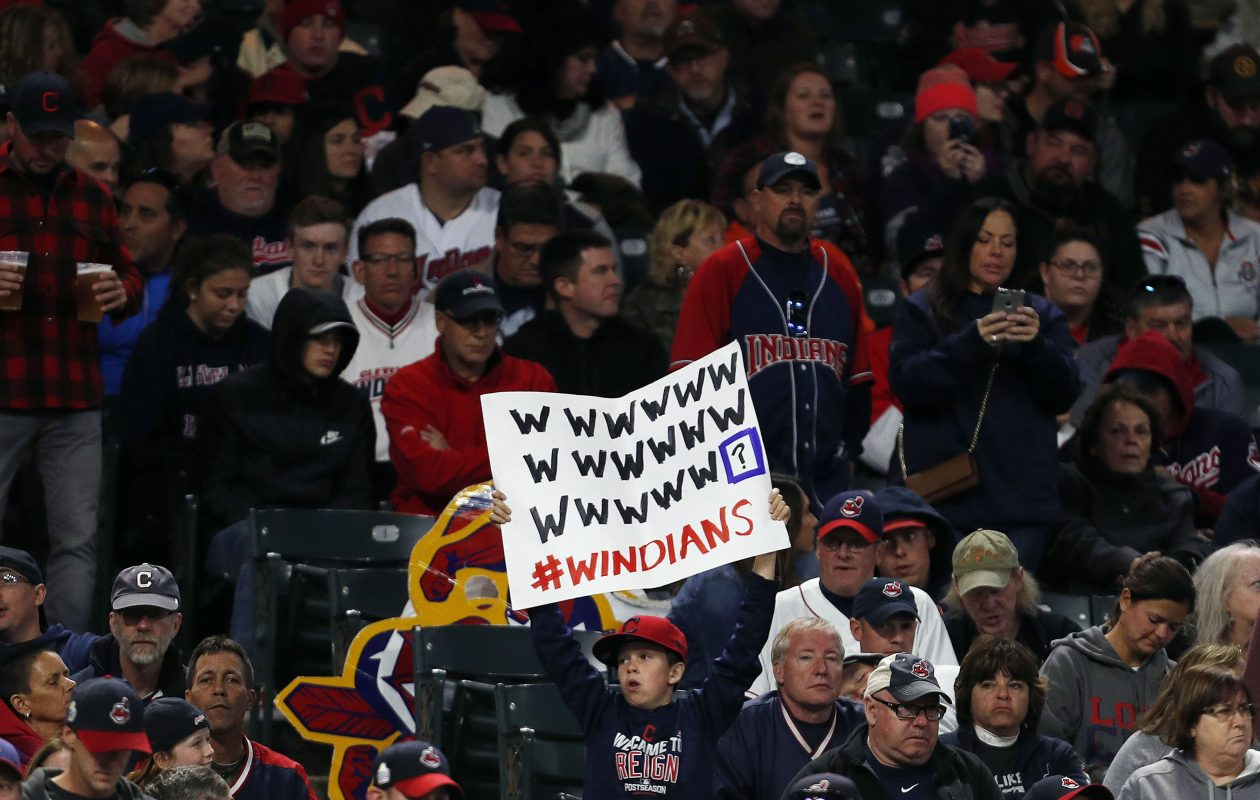 CLEVELAND, OH – SEPTEMBER 10:  Cleveland Indians fans hold signs supporting the Indians' win streak in the ninth inning against the Baltimore Orioles at Progressive Field on September 10, 2017 in Cleveland, Ohio. The Indians defeated the Orioles 3-2, and their win streak now stands at 18.  (Photo by David Maxwell/Getty Images)