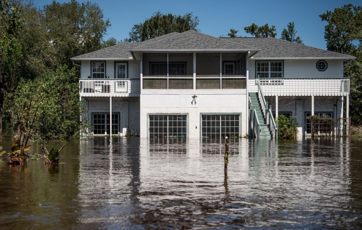 How can cities better plan to prevent or handle the devastation caused by hurricanes, or – even broader – the concerns that accompany a warming climate? (Photo by Sean Rayford/Getty Images)