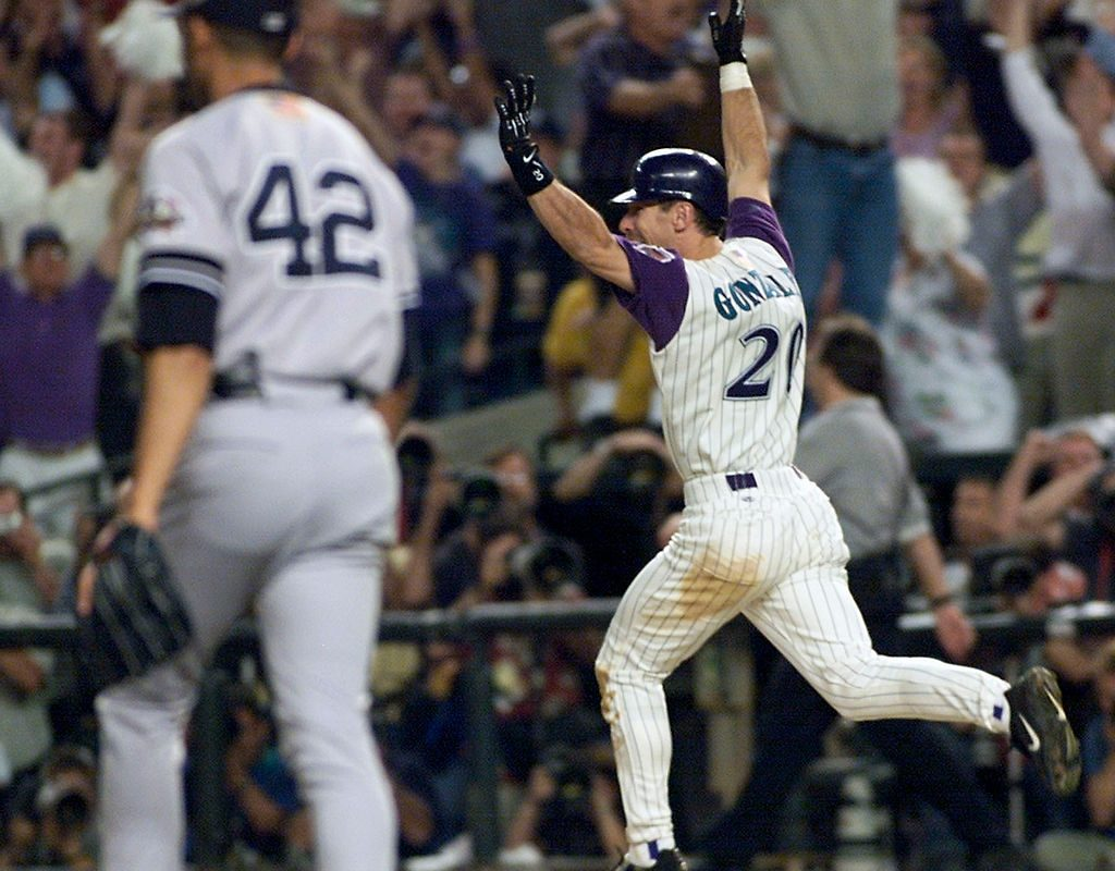 Luis Gonzalez celebrates his game-winning RBI single in the bottom of the ninth off  Mariano Rivera that won Game Seven of the 2001 World Series (TIMOTHY A. CLARY/AFP/Getty Images).