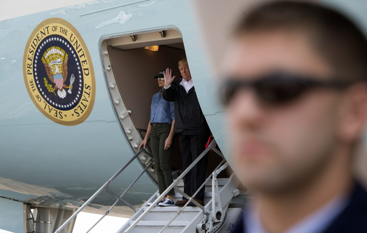 President Donald Trump descends from Air Force One alongside first lady Melania Trump, at Ellington Field Joint Reserve Base in Houston, Sept. 2, 2017. Trump will meet with state officials, lawmakers and other individuals impacted by Hurricane Harvey. (Tom Brenner/The New York Times)