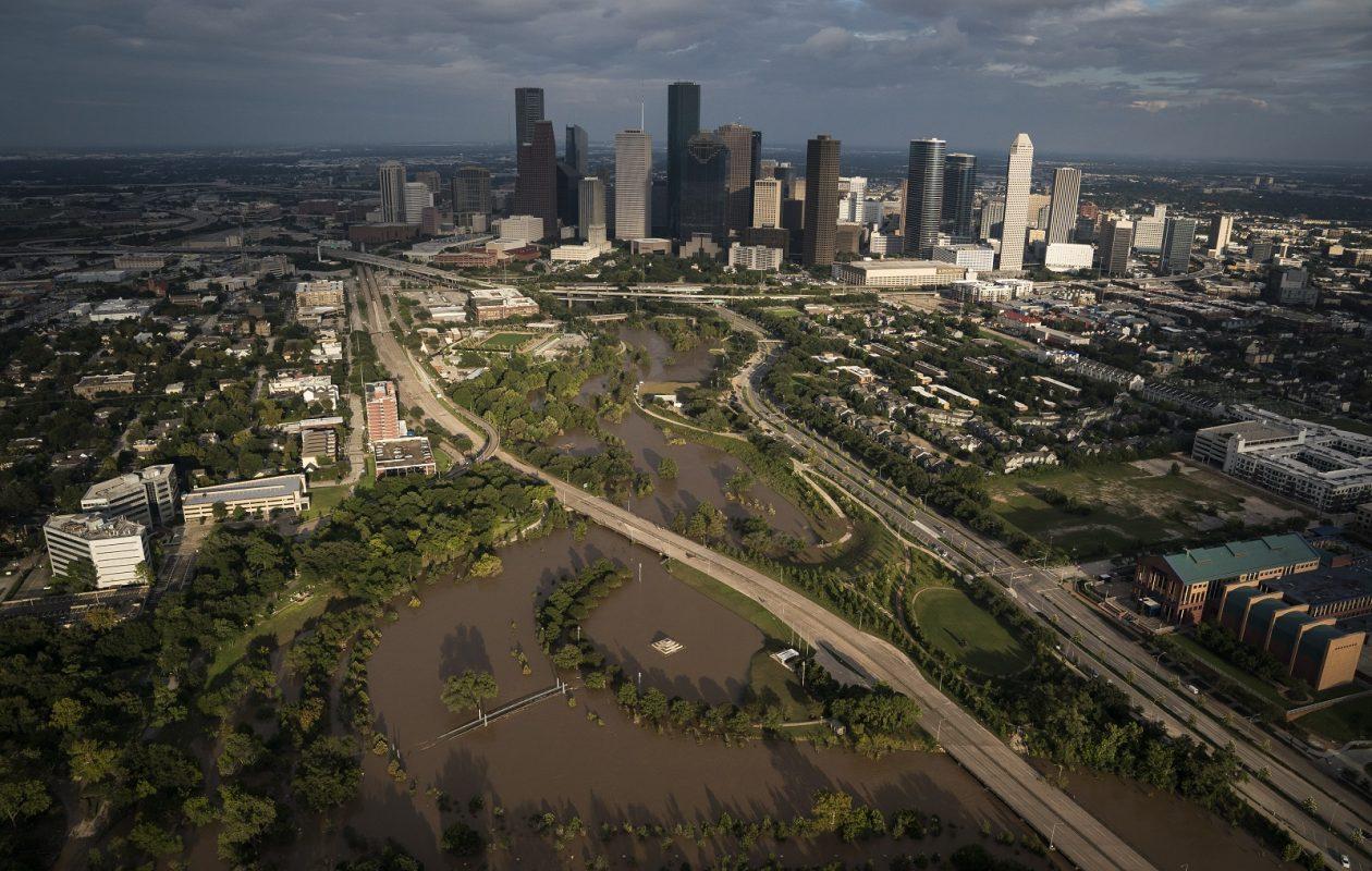 The sun sets on downtown Houston as flood waters still surround some neighborhoods. (Jabin Botsford/Washington Post)