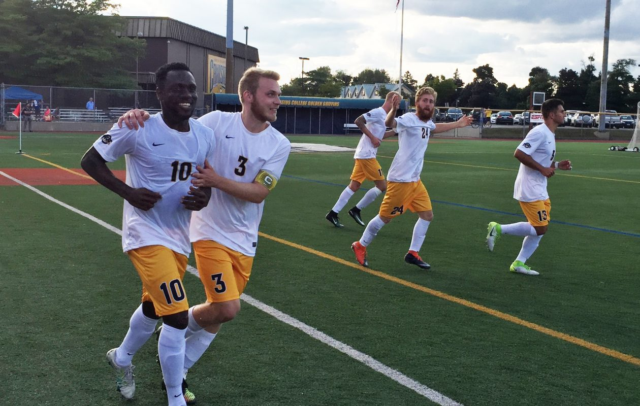 Canisius' Melvin Blair (10) is congratulated by Bjarki Benediktsson after a goal. (Ben Tsujimoto/Buffalo News)