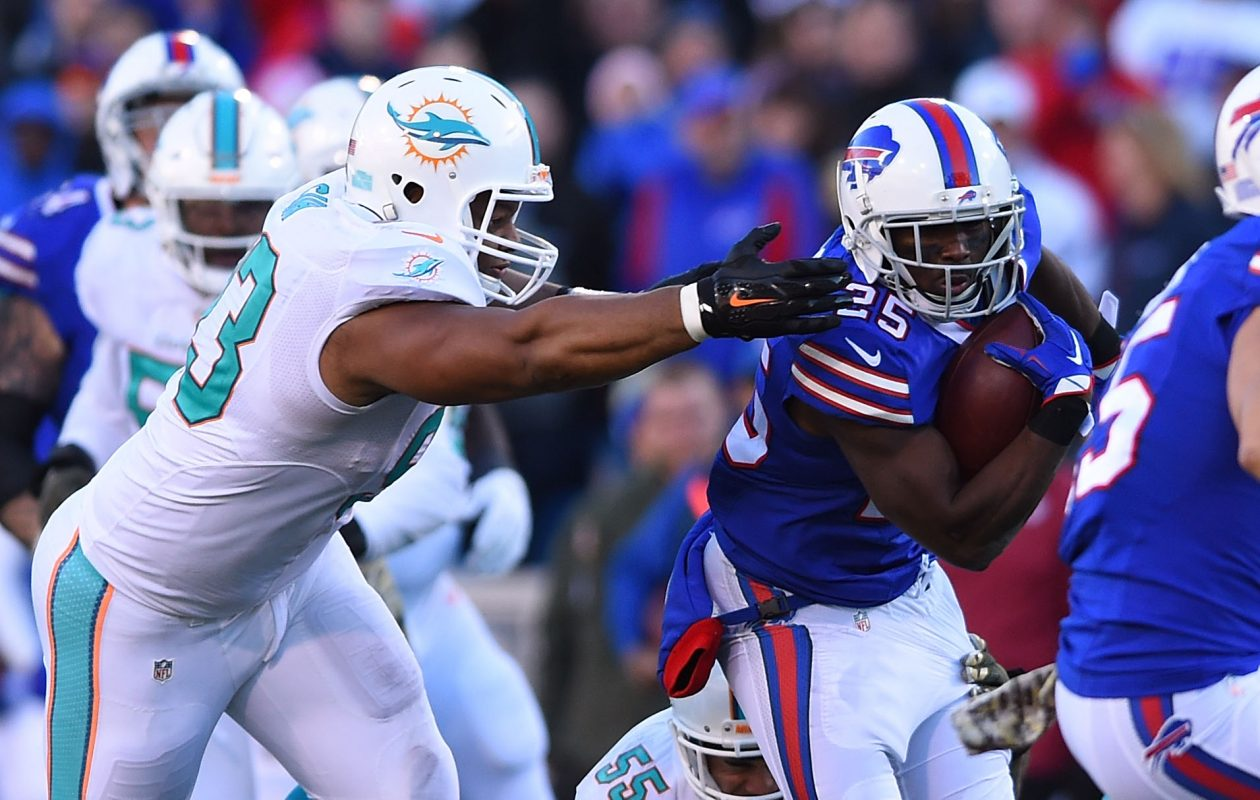 New Bills linebacker Jelani Jenkins pursues new teammate LeSean McCoy when Jenkins was with the Miami Dolphins. (Rich Barnes/Getty Images)