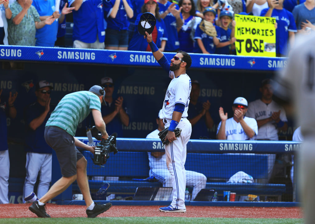 Jose Bautista tips his hat to the fans after he was pulled from the game in the ninth inning (Getty Images).