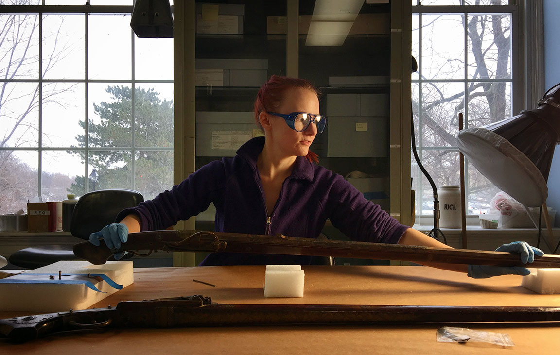 Katrina Zacharias, a student in objects conservation, works on a sword. (Buffalo State College)